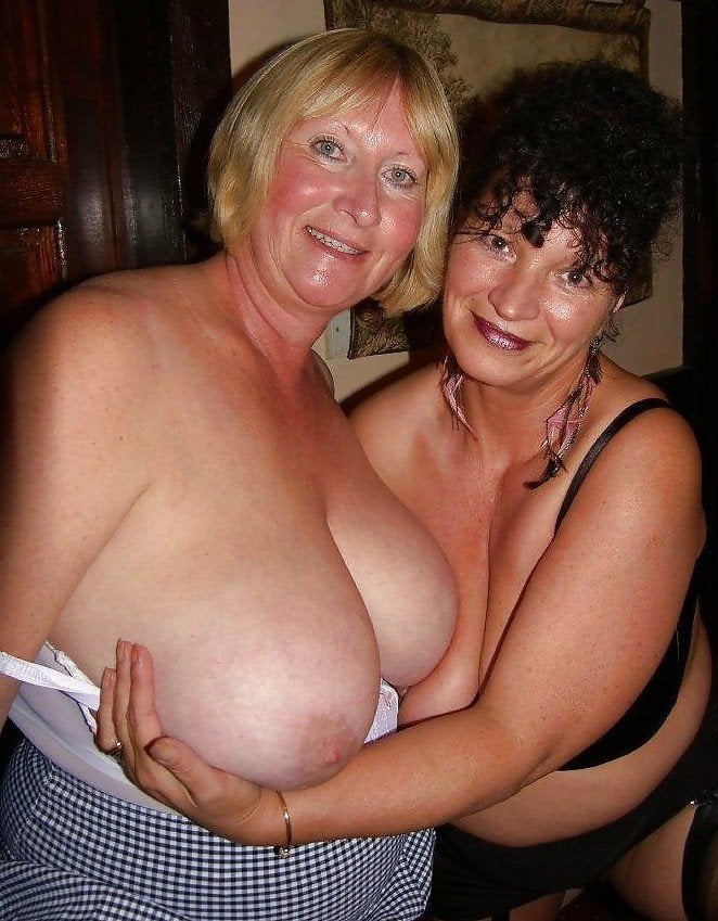 two hot naked girls sucking breasts